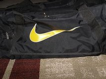 Nike Medium Duffle Bag, Black Grip Bag is Black with Yellow Nike Symbol sc 61 in Huntington Beach, California