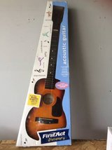 Childs First Guitar in Fort Lewis, Washington