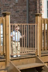 "Cardinal Gates Outdoor Child Safety Gate, Brown. Width is 27"" to 42.5"" in Naperville, Illinois"