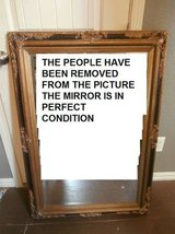 Antique ornate gold and black wood framed mirror in Cleveland, Texas