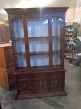China Cabinet with glass doors and overhead light in Fort Leonard Wood, Missouri