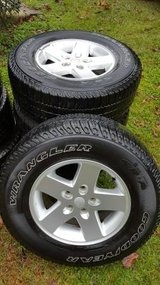 Factory Jeep wheels and tires in Fort Polk, Louisiana