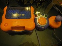 vtech v.smile tv learning system w/6 games in Kingwood, Texas