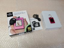 Brand New the sharper image 1.4''digital photo album with keychain usb2.0 rechargeable in Joliet, Illinois