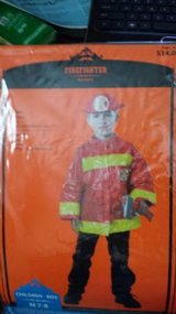 Firefighter costume, new, size M (7-8) in San Diego, California