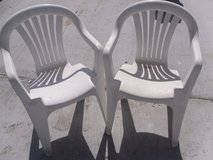 lot of (4) various white plastic patio, porch, lawn, pool, outdoor chairs 110175 in Huntington Beach, California