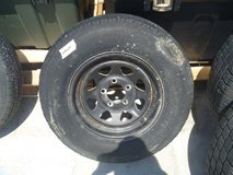 excellent used duro trailer tire with white rim 14 5 bolt rim 205/75r14 80294 in Fort Carson, Colorado