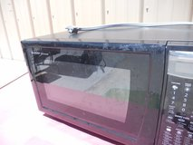 pre-owned sharp r403jk 1100 watt 1.5cu. ft. mid size microwave oven black 60473 in Huntington Beach, California