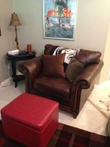 Brown leather oversized chair in Yorkville, Illinois