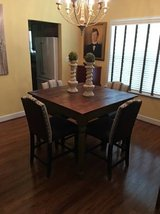 Distressed Counter Height Dining Table with 4 leather chairs in Fairfax, Virginia