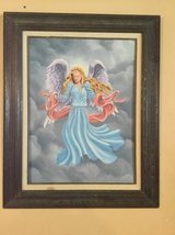 Painted angel picture in antique frame in Fort Riley, Kansas