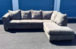 Gray Two Piece Sectional Couch in Camp Lejeune, North Carolina
