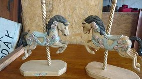 Pair of wood carousel horses on stands in Fort Leavenworth, Kansas