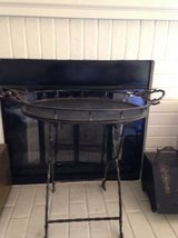 Wrought Iron Occassional table - it folds indoor and outdoor in Roseville, California