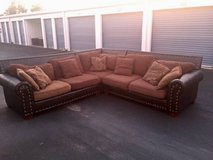 Brown Leather and Fabric Oversized Sectional Couch in Camp Lejeune, North Carolina
