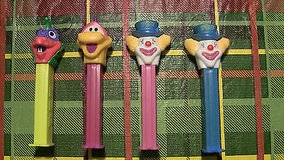 lot of 4 pez 2 dinosaurs 2 clowns blue purple l-saur fly-saur in Glendale Heights, Illinois