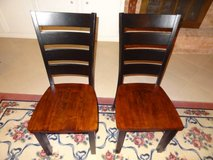 pair of laddar back black and cherry dining room chairs in Conroe, Texas