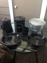 Camping silver and speckled black cookware plates cups coffee pot in Beale AFB, California