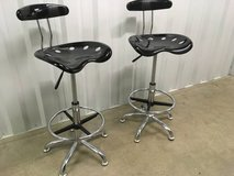 Two black and chrome adjustable barstools in Naperville, Illinois