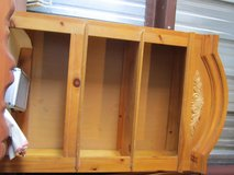 pre owned wood cared head decorated hanging wall cupboard wood blonde    90168 in Fort Carson, Colorado