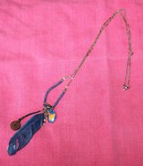 Fashion Jewelry Necklace - Blue Beads, Feather, Assorted Charms, Gold Tone Chain in Naperville, Illinois