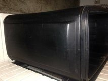 Large black rolling raised planter or very large party cooler has drai in Beale AFB, California