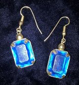Vintage gold tone baguette cut blue stone pierced dangling earrings in Riverside, California