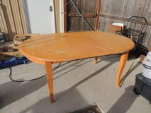 solid wood kitchen/dining table w/ removable leaf tall table light color local in Fort Carson, Colorado
