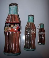 1996 lot of 3 coca-cola collectible pop bottle shaped tin. great graphics in Plainfield, Illinois