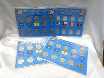 commemorative state quarters 3- 1999 year sets and 2004 empty coin cut out in Camp Lejeune, North Carolina