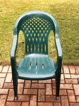 Set of 5 green plastic stackable patio chairs in Bolingbrook, Illinois