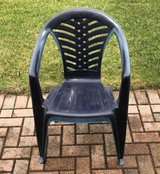 Set of 4 blue plastic stackable patio chairs in Bolingbrook, Illinois