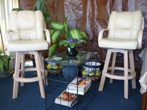 Leather and wood bar height swivel chairs in Yucca Valley, California