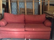 Red love seat couch in Naperville, Illinois