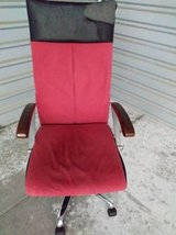 Red executive adjustable chair with wood grain in Sacramento, California