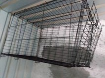Rough used dog kennel with no tray in Sacramento, California