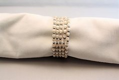 Silver tone white plastic bead wrap around statement chain bangle in Kingwood, Texas