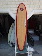 Surfboard > 7 foot bamboo funboard with nice fins in Wilmington, North Carolina