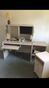 Desk with cabinet storage drawers and shelves in Vista, California