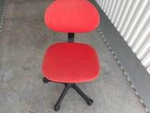 Red Armless Task Chair can raise or lower in Sacramento, California