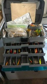 Tackle box full of lures with 3 rods and reels in Fort Leavenworth, Kansas