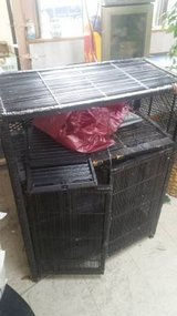 black wicker storage shelf/cabinet in DeKalb, Illinois