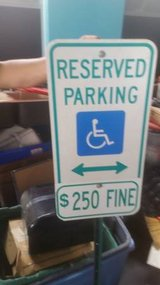 reserved handicapped parking sign on pole in DeKalb, Illinois