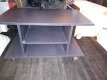 black wood rolling entertainment center or book case in Roseville, California