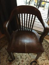 Vintage solid walnut banker's office chair in Tampa, Florida