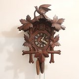 antique 1930s black forest cuckoo clock working large bird wood carving in Ramstein, Germany