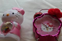 Hello Kitty, alarm clocks, bedside clocks, earrings, Guess watch in Bellaire, Texas