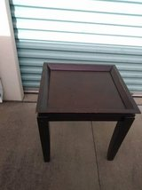 End Table that has a Tray Top Dark wood in Roseville, California