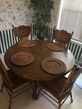 MOVING SALE:  furniture solid oak dinning kitchen  table 6 chairs +  2 bar stools in Cochran, Georgia