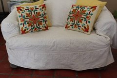 Comfortable Loveseat with white cover in Pearland, Texas